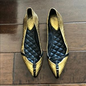 Gold and black flats